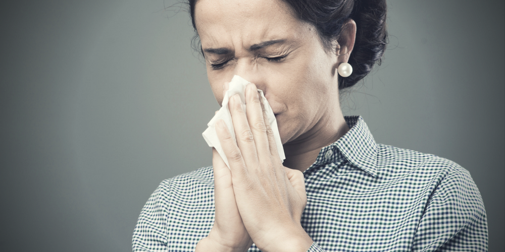 woman blowing nose - heating