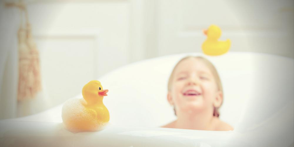 girl in bath - tankless water heaters